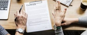 Author signing a contract with an agent