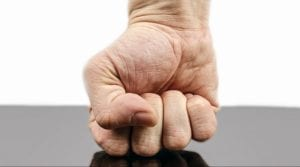 A fist hitting a table - internal conflict vs external conflict