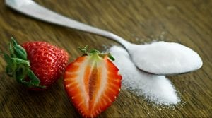 A spoonful of sugar with some strawberries