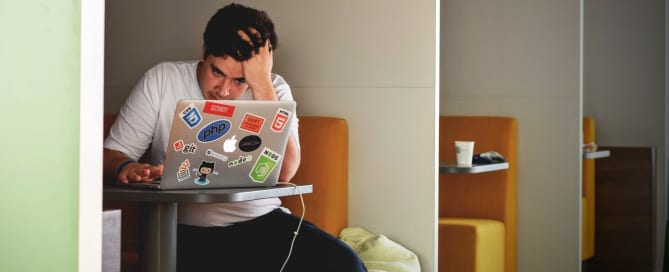 Man looking frustrated at laptop - How hard is it to get a book published?