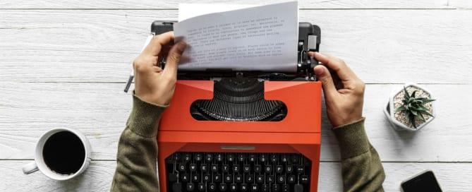 Manuscript page in typewriter - top mistakes in self-publishing