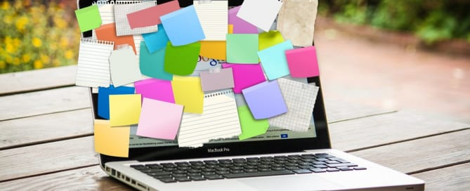 Laptop with sticky notes all over the screen