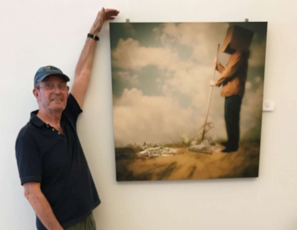 Author Nicholas B James presenting his photographic art in a gallery